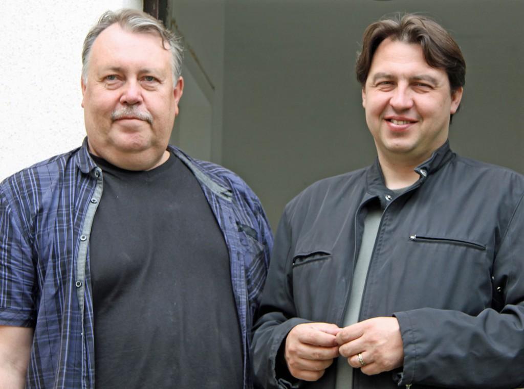 Arunas Sulslup und Pastor Mindaugas Kairys (re).